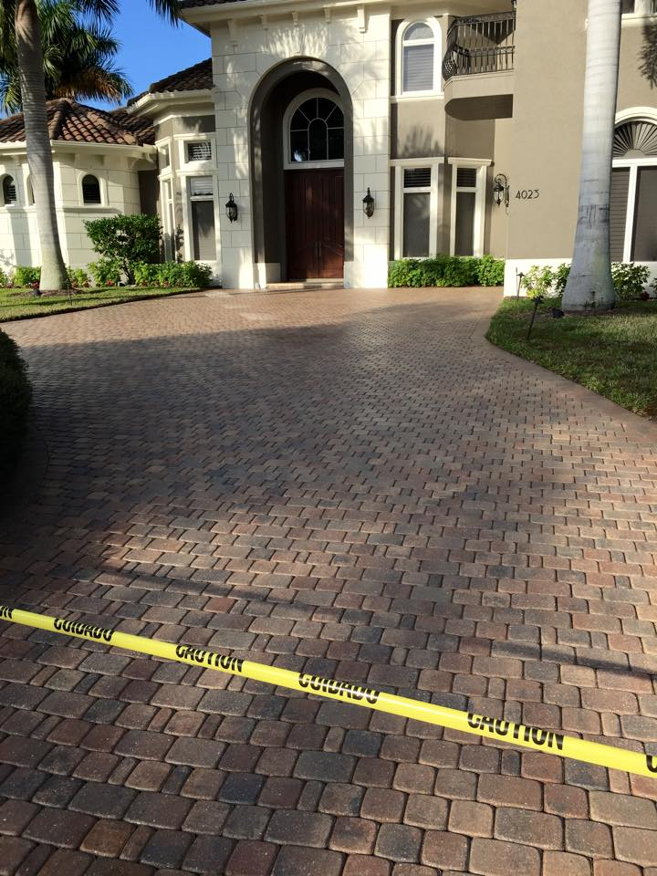 Paver stone cleaning and sealing services provided by your local Window Genie.